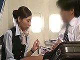 Japanese hoe gives handjob in a plane
