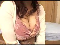 Japanese milf gets her big tits cummed