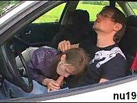 Cute teen blowing cock in a car