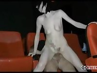 German couple and a voyuer in a cinema