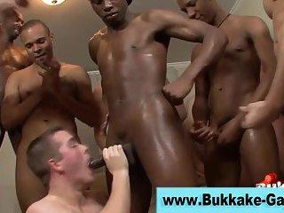 Twink gets bukkake during group action
